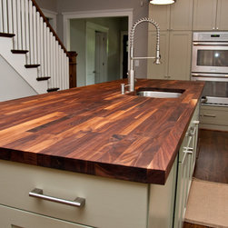 Custom Walnut Butcher Block Counter - A custom butcher Block counter created for the space adds warmth with its natural wood tones.