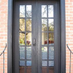 Mediterranean Iron Doors - French 10-lite iron door by The Front Door Company in Alamo Heights area in San Antonio, TX.