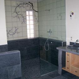 Master Bathroom- North Liberty, Iowa - Shower area w/pebble-stone floor, Vola fixtures, custom maple vanity