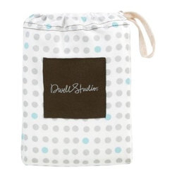 Traffic Dot Light Blue Fitted Crib Sheet - Dwell Studio has the best fitted sheets. They come in a range of patterns that would fit any nursery decor, and many are gender neutral. This pattern is one of my favorites — soft subtle dots of blue and gray.