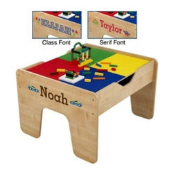 "KidKraft Personalized 2-in-1 Activity Table with Lego Board - Get ready for hours of fun and play with the KidKraft Personalized 2-in-1 Activity Table with Lego Board. Finished in neutral natural wood with a bright green and red tabletop this activity table includes a two-sided board with a train layout on one side and a Lego-compatible surface on the other. The table also comes with a 30-piece train set and 200 Lego blocks so your little one can play happily for hours while learning and growing through creative imaginative play. Dimensions: 27L x 23W x 17H inches. The Beauty and Benefits of RubberwoodHailing from the maple family of trees the rubber tree is used in the manufacture of high-end furniture. This durable Asian hardwood is valued for its dense grain minimal shrinkage attractive color and acceptance of different finishes. It is also prized as an """"environmentally friendly"""" wood as it makes use of trees that have been cut down at the end of their latex-producing cycle. About KidKraftKidKraft is a leading creator manufacturer and distributor of children's furniture toy gift and room accessory items. KidKraft's headquarters in Dallas Texas serves as the nerve center for the company's design operations and distribution networks. With the company mission emphasizing quality design dependability and competitive pricing KidKraft has consistently experienced double-digit growth. It's a name parents can trust for high-quality safe innovative children's toys and furniture."