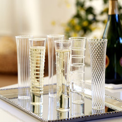 Mardi Gras Sparkling Wine Flutes - Mardi Gras Flutes 6-Pack. Made from hand-worked borosilicate glass, these textured flutes will add sparkle and personality to any party.
