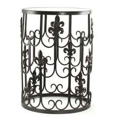 None - 'Fleur-de-Lis' Metal Barrel End Table - This stylish barrel end table features a beautiful oil-rubbed bronze finish with a glass top. Lightweight and sturdy, this versatile table provides an elegant highlight that is versatile enough to work with a range of decorative themes.