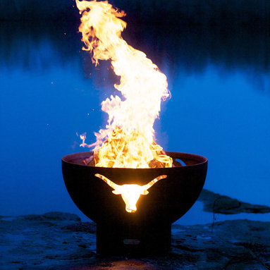 """Fire Pits - Great for Fall and Winter - Whether you're a lifelong sports fan of the Texas Longhorns or enjoy general Southwestern design aesthetic, you'll appreciate the rustic design of the Longhorn 36"""" Fire Pit. This wood burning fire pit is made from the heaviest gauge steel available, ensuring that you'll have this functional piece of fire pit art as part of your outdoor collection for many years in the future. The Longhorn 36"""" Fire Pit is not just a practical fire pit; it is a piece of art in its own right. It has a standard iron oxide patina finish on the outside. The iron oxide patina will darken a little with time before becoming permanent. The inside is coated with a high temperature resistant paint and has a rain drain in the bottom. The base of the fire pit has an inside weld to give a smooth and clean look on the outside while maintaining the integrity of the piece."""