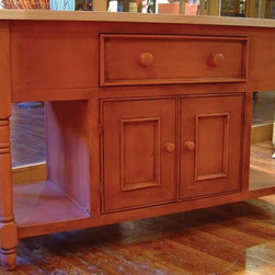"""British Traditions - 5 Ft. Wide Rectangular Kitchen Island w Unfinished Maple Top (Highlands Pine) - Finish: Highlands Pine. Each finish is hand painted and actual finish color may differ from those show for this product. Rectangular kitchen island. 1 Drawer. Drawers on each short end and front. Paneled off on back. 2 Doors over open cabinet. Open shelves at sides. No shelves inside the cabinet. Working drawers at sides. Unfinished maple routed top has trimmed edging. Minimal assembly required. Overhang: 6 in.. Main cabinet: 58 in. W x 24 in. D x 34.25 in. H. Base cabinet: 26.5 in. W x 18 in. H. Overall: 60 in. W x 30 in. D x 36 in. H (198 lbs.)One of our best-selling pieces, the Hampshire island has both commercial and residential applications. It has handsome turned legs and plenty of drawer and cupboard space punctuated with traditional English """"long-neck"""" wooden knobs. Great for gourmet and cookware display, but equally at home in the residential country kitchen, the island also has two open shelves in the base to hold baskets, large pots or crockery and the 60 in. x 30 in. butcher-block top provides plenty of work space."""