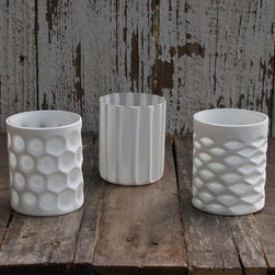 Dagmar Tealight Holder - The different patterns on the tealight holders make a terrific combination when put together. The simple white color is saved from boring by the innovative cutouts. I'm sure they throw beautiful light from the openings.