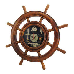 Ship`s Wheel Nautical Wall Clock  20 In. Diameter - This beautiful wall clock is a wonderful addition to the home of sailing enthusiasts, and complements nautical decor. It features a wooden ship`s wheel and measures approximately 20 inches in diameter. The 6 inch diameter clock face has nautical knots with plaques to identify them, Roman numerals to mark the hours, and it has a mariner`s compass in the center. The clock features quartz movement and runs on 1 AA battery (not included). This piece is an eye-catching accent in your home or office, and makes a great gift for a friend.
