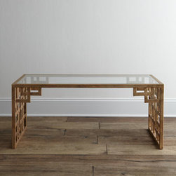 "Horchow - Lovelace Coffee Table - Exclusively ours. Asian-style fretwork detailing on the ends and apron adds interest to the otherwise clean lines of this glass-topped coffee table. Handcrafted of welded iron. Hand-painted antiqued-gold finish. 44""W x 22""D x 19""T. Imported. Boxe..."
