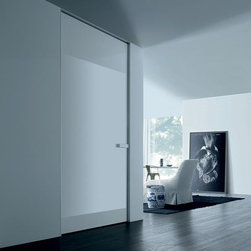 Hidden Doors - It has never been easier to hide your secret entrance. Featuring invisible hinges and frame-less casing, invisible doors make your interiors look like one piece. When combined with the right wall panels they add that unique elegance to the wall of your choice. Whether you are looking for an Italian veneered door, Formica, lacquer paint, solid wood, glass or any other specific synthetic material at Dayoris you'll find a large variety of these designs built with the finest European materials to match your interiors with immaculate perfection.