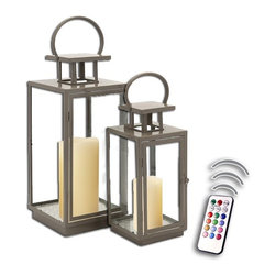 """Asian Import + USA - Toupe Contemporary Lanterns with Flameless Wax Color Candles - The Asian inspired Contemporary Lanterns help you create a delightful display of candlelight. Crafted of iron with clear glass panels, these lanterns make a great centerpiece on a coffee table or flanking the fireplace mantle. 13"""" and 18"""" high.""""Included are 4"""" and 5"""" Avion Select melted edge color candles with remote control timer. Note that candles pictured are for presentation only. The candles included in the set are described above. Set of 2"""