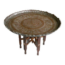 1920s Moroccan Pharaoh Table - Beautiful hand etched and hammered vintage Moorish table. This unique piece came from an estate in Santa Ana, California. It's very old, most likely 1920's or possibly earlier. It has an etched metal brass tray and folding wooden base. The base is hand carved and inlaid with bone. The tray has a rare etched Pharaoh design and is finished with a hand hammered scalloped edge. It would be great as a coffee table. In good vintage condition with wear consistent with both age and use. Base has most wear on outside of two of its legs; no missing inlaid bone. Tray has some wear, as well, mostly underneath (please see photos).