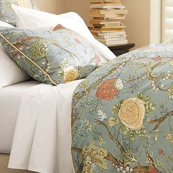 Wells Palampore Duvet Cover, Full/Queen, Blue - Bold palampore motifs flourish in a rich, saturated palette against a soft blue background. Printed front and back on textured cotton-linen, and edged with a narrow frame of ivory piping. Cotton-linen. Duvet cover has a hidden button closure and interior ties to keep the duvet in place. Sham has an envelope closure; insert is sold separately. Machine wash. Catalog / Internet Only. Imported.