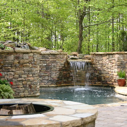"Pools - This entertaining area includes a ""Spool"" which is a small pool or large Spa. It is approximately 250 sf of surface and has several areas where one can sit and enjoy tyhe hydrotherapy jets. It has a waterfall falloing into the spool; a fire pit nearby, with a Paver pool deck."