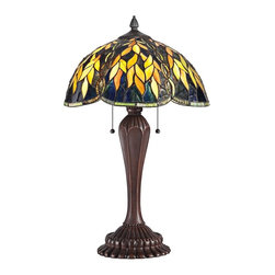 "Quoizel - Tiffany Quoizel Grove Tiffany Style Table Lamp - The handsome and versatile Tiffany style table lamp features deep black glass enhanced with bold yellows and oranges. Scalloped shade edges add to its inviting allure. The fittingly detailed russet finish metal base enhances the authenticity of this iconic home accent. Two lights are controlled by dual pull chains. This elegant Quoizel lamp will warm your home with its enduring glow. Orange yellow and black art glass table lamp. Rich Russet finish. Metal construction. Round multicolor art glass shade. Shade constructed of 354 pieces of stained glass. Two max 75 watt bulbs (not included). 26"" high. Shade is 16"" wide.   Orange yellow and black art glass table lamp.  Rich Russet finish.  Metal construction.  Round multicolor art glass shade.  Shade constructed of 354 pieces of stained glass.  Two max 75 watt bulbs (not included).  26"" high.  Shade is 16"" wide."