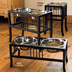 Wrought Iron Raised Mission-style Dog Feeders/Dog Bowls - These wrought iron pet feeders from Orvis are a great way to feed your pet. They come in a variety of sizes and heights to accommodate your dog. I like that they're not very clunky looking and that you can see through the stands. These could almost blend in with your home decor.