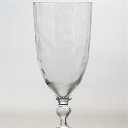 """Juliska - Juliska Octavia Small Goblet Clear - Juliska Octavia Sm. Goblet Clear. Add artistic interest to the table with this glass that has a hammered-metal effect that walks the line between cool modernism and old world craftsmanship. Dimensions: 7.5"""" H Capacity: 10 oz"""