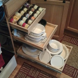 ShelfGenie Glide-Out Shelves - Create custom combinations of pull out shelving solutions.  Featured here are the spice rack pull out drawer and two single-height pull out shelves,