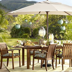"""Chatham Rectangular Butterfly Extension Table & Stacking Chair Set - Dining alfresco is a quintessential summer pleasure, and our Chatham Collection makes it better than ever. Crafted of solid mahogany, our dining table and chair set lets you create a welcoming outdoor dining space instantly. Two drop-in leaves make room for more guests at the table, and the stackable armchairs are easy to store. Click to read an article on {{link path='pages/popups/chatham-care_popup.html' class='popup' width='640' height='700'}}recommended care{{/link}}. Table: 74"""" long x 40"""" wide x 30"""" high; extends to 106"""" long Armchair: 24"""" wide x 25.5"""" deep x 35.5"""" high Side Chair: 19"""" wide x 25"""" deep x 35.5"""" high Crafted of solid mahogany and sealed for moisture resistance. Butterfly extensions increase the table's length, and store conveniently under the top. An opening at the center accommodates all of our outdoor umbrellas. Exposed hardware is finished in Antique Brass. Seats up to 10. Sunbrella(R) cushions and slipcovers are special order items which receive delivery in 3-4 weeks. Please click on the shipping tab for shipping and return information. View our {{link path='pages/popups/fb-outdoor.html' class='popup' width='480' height='300'}}Furniture Brochure{{/link}}."""