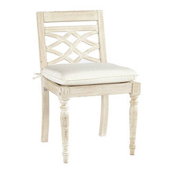 Ballard Designs - Ceylon Whitewash Dining Side Chair - Basic sand cushion included. Eucalyptus wood suitable for covered outdoor use. Assembly required. Replacement cushions available. Requires 1 replacement cushion per chair. Use of an outdoor furniture cover is recommended to extend the life of your piece. With its refined, hand-carved details, our Ceylon Side Chair captures the relaxed elegance of classic British Colonial style. The Ceylon Whitewash Collection is crafted of sturdy FSC certified eucalyptus wood to resist harsh weather and damaging insects. Small cracks may develop and are considered a natural characteristic of this durable wood.Ceylon Dining Side Chair features: . . . . .