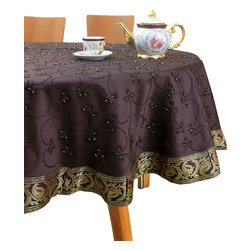 """Banarsi Designs - Hand Embroidered Round Tablecloth (Beige, 70"""" Round) - Transform any tabletop into a display of art with the exclusive Hand Embroidered Round Tablecloth from our Banarsi Designs collection, available in two sizes: 70-Inch Round and 85-Inch Round. Crafted in India, this tablecloth incorporates hand embroidered beads throughout the entire abstract design and is available in a variety of bold colors. Our tablecloths are ideal for decorating your tables for every occasion and also make wonderful gift ideas. Banarsi Designs Exclusive"""