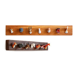 Pack Rack - This coat rack is so cute I don't think I could bear to hang anything on it. Well, maybe a dog leash or something. The plastic menagerie of animals is just too clever.