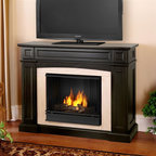 """Real Flame - Rutherford Ventless Gel Fireplace in Dark Wal - Solid wood and veneered MDF construction.. Shelf dimensions:13.75"""" x 5.5"""". Includes: MDF mantel, firebox, hand painted cast concrete log and screen kit.. Uses Only Real Flame 13oz Gel Fuel Cans, not included. Uses clean burning Real Flame Gel fuel emitting up to 9,000 BTUs of heat per hour lasting up to 3 hours. Assembly Required. 46.5 in. W x 16 in. D x 37.5 in. H (127 lbs.)Disguised as a standard TV supporting mantel; with it's contrasting arched center panel, detailed recesses, and prominent profile - one would almost never guess that the Rutherford is hiding storage space for a multitude of media. A magnetically secured, flip down door easily opens to reveal A/V components, while hidden doors on either side of the firebox conceal almost 100 DVDs."""