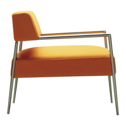 Fabra Armchair, Orange - A true celebration of contemporary minimalism, the Fabra elevates the conventional definition of an armchair. The backrest is low but its inclination leads to an excellent back support. A special highlight of the piece is the frame of the arms/legs made of steel tube, which gives the product dynamism that transmits itself into the surrounding space. Casual yet elegant, this piece is ideal for contract projects. Chrome structure and orange upholstery.