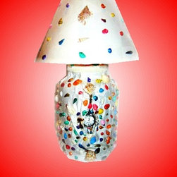 Sea Time Light - TEDDEEZtm African Brocade Sea Time Light Lamp is creatively named. Beautiful, colorful sea shells adorn white brocade fabric, removeable time piece is on the front with lovely matching shade.