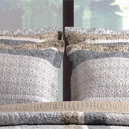 None - Soho Standard Quilted Shams (Set of 2) - Rows of modern stencil prints in updated floral and rococo motifs on a neutral ground, the Soho quilt set defines metro chic style. Metallic tones of grey, washed-out gold and pewter are fashion-forward and match any color scheme.