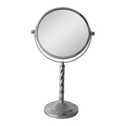None - Free Standing 5X Magnifying Makeup Mirror - The free standing makeup mirror in a chrome finish is a beautiful addition to your bathroom. It sits on a decorative twisted stand and features 5X magnification.  Mirror size - 6 inch.