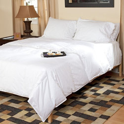 Belle Epoque - Belle Epoque Down Comforter - Light Weight - 80510 - Shop for Comforters from Hayneedle.com! Perfect for warmer climates and summer nights the Belle Epoque Cirrus Down Comforter - Light Weight is also the ideal comforter for hot sleepers in general. This lightweight thin comforter harnesses the temperature-modulating properties of down and feathers to keep you cool so you can rest peacefully.With a cover made from soft 100% cotton this comforter is stuffed with a blend of white goose down and feathers with a fill power of over 400. The baffled box-stitch construction uses an inner wall of fabric to let the fill loft to achieve its maximum capacity while the quilted pattern keeps the stuffing evenly distributed throughout the comforter. Extra-large squares provide a simple clean look that will open up small bedrooms. This comforter is conveniently machine-washable and is covered by a three-year limited warranty.Comforter Dimensions:Twin: 66 x 88 inchesFull/Queen: 88 x 88 inchesKing: 104 x 88 inchesAbout CGG Home FashionsWhether you are shopping at Bloomingdale's or relaxing at a premier resort you are sure to find and appreciate CGG Home Fashions products. For over 20 years the company has been offering a broad selection of luxury linens high thread count sheets duvet covers pillows down and synthetic comforters drapes and table linens. CGG's acclaimed Belle Epoque collection is the epitome of elegance with styles ranging from traditional to contemporary. With offices and a warehouse in Yonkers New York and a showroom on New York's Fifth Avenue CGG is at the epicenter of textile design and innovation.