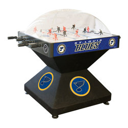 Holland Bar Stool - Holland Bar Stool DHSTLBlu St Louis Blues Dome Hockey - DHSTLBlu St Louis Blues Dome Hockey belongs to NHL Collection by Holland Bar Stool Holland Bar Stool's Officially Licensed Dome Hockey game provides hours of entertainment for the hockey fan of any level. Game is badged with your favorite team's logo on the base, sides, and at center ice. Our high-performance rod assembly underneath the surface transfers your twisting motion with a 2:1 ratio onto your players for the most responsive game play, and the clutch system prevents damage to the players when battling the opposition. TPR octagonal, sure-grip handles are attached to high-tensile steel rods that are ground and plated, maneuvering ABS players who are steel re-enforced to provide you with a long lasting game. Side mounted scoring unit provides a variety of game modes, Base includes adjustable levelers. When completing your game room, show your team pride with a Dome Hockey table from the Holland Bar Stool Company. Dome Hockey (1)