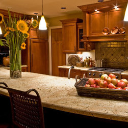 Street of Dreams - This Street of Dreams kitchen was topped with a slabs of granite giving the room a feel of life time quality.