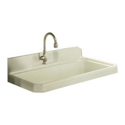KOHLER - KOHLER K-6607-1-0 Harborview Self-Rimming or Wall-Mount Utility Sink with Single - KOHLER K-6607-1-0 Harborview Self-Rimming or Wall-Mount Utility Sink with Single-Hole Faucet Drilling on Center Deck of Sink in WhiteThis Harborview countertop sink forms a generous workspace that serves double duty as a kitchen or utility sink. Constructed of durable KOHLER Cast Iron, this model features a single-hole faucet drilling, an integrated apron and backsplash, and a wide, single-basin design. The apron and underside are glazed the same color as the basin, and multiple installation options  -  countertop or wall-mount with fireclay legs  -  ensure versatility for your design vision.Please see our Delivery Notes for Freight Shipments for products that are oversized and/or are too heavy to ship UPS ground. KOHLER K-6607-1-0 Harborview Self-Rimming or Wall-Mount Utility Sink with Single-Hole Faucet Drilling on Center Deck of Sink in White, Features:• Generous workspace performs double duty as a kitchen or utility sink