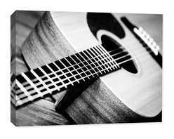 Doodlefish - Acoustic Guitar - The Guitar Collection of Acoustic and Electric Guitar photography from Doodlefish is perfect for a teen or tweens room. It would also be great for a music room or basement space. The guitars are from the collection of a special young man who shared them for this project. This piece is a cool angle on the body of an acoustic guitar and is measures 16x24. The canvas printed artwork is gallery wrapped around the stretcher bars with a mirror image of the of the image ffor visual interest. Each piece can be hung in many combinations and orientations.