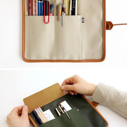 The Basic Canvas Roll Pencil Case - Pens, pencils, rulers and markers — keep it all organized and in one place with this stylish canvas pencil case. I have one of these for my paintbrushes.