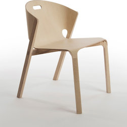 Pelt Chairs - Pelt is a stacking dining chair comprised of plywood and solid ash. The plywood shell wraps around a solid ash frame, akin the skin over an animal's skeleton.