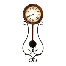 Howard Miller - Kersen Wall Clock in Warm Antique Gray Finish - Wrought-Iron pendulum wall clock with warm antique Gray finish and a profiled wood bezel finished in Americana Cherry. Pendulum features a warm antique-Gray bob suspended from a Cherry finished wood stick. The off-white, graduated tone dial features Black Roman numerals, Black spade hands, and a convex Glass Crystal. Quartz, battery-operated movement. Requires 2 AA batteries, not included. 8 in. W x 2 1/2 in. D x 22 1/2 in. H