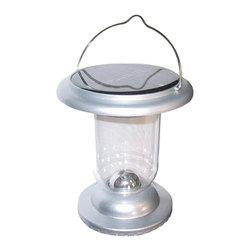 """Lamps Plus - LED Solar Powered Portable Lantern - This solar powered outdoor light is engineered for ease of use outdoors with weather and impact resistant ABS plastic. The two included batteries enable up to 7 hours on a full charge. A photocell sensor enables auto-on switch at night. Also includes a manual on/off switch. The 50 lumens of brightness allow 80 square feet of coverage. Includes two 1.2 volt batteries. Silver finish. Auto-on light sensor switch. Manual on/off switch. Solar-powered batteries. Full charge allows 7 hours of light. ABS plastic construction. 6"""" high. 5 1/2"""" wide.  Silver finish.    Auto-on light sensor switch.   Manual on/off switch.   Solar-powered batteries.   Full charge allows 7 hours of light.   ABS plastic construction.   Rated at 50 lumens.  Comparable to a 7 watt incandescent bulb.  6"""" high.   5 1/2"""" wide."""