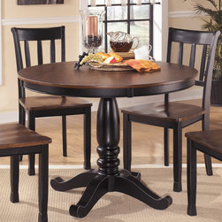 Signature Design by Ashley - Signature Design by Ashley Round Dining Room Table - A two-tone finish offers a versatile,timeless design to this fine table from Ashley Furniture. This beautiful table base and top features place settings for four people and durable materials.