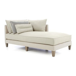 Asana Right Arm Sectional Chaise - High-drama living space centerpiece makes a grand statement in long clean lines, deep seating, comfort zone-creating cushions and layers of textures and neutrals. Grand, tuxedo-style design makes Asana ideal for socializing around the coffee table, as a tranquil curl-up hideaway, or a stretch-out spot for enjoying a good book or catnap. Layered fabrics begin with a bright cream cotton-poly covering to its slim frame. Seat, back and bolster cushions and kidney pillows layer it on in a vanilla linen-blend along with lustrous velvet box pillows in smoke. Casual elegance—warm, clean and current—anchored on six tapered hardwood legs.
