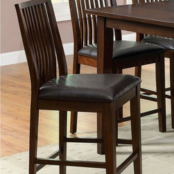 Furniture of America - Furniture of America Alliani 2-Piece Counter Height Dining Chairs - Walnut Brown - Shop for Dining Chairs from Hayneedle.com! Complete your counter height table with these Furniture of America Alliani 2-Piece Counter Height Dining Side Chairs Walnut. Slightly tapered legs contemporary faux leather upholstery and a bold yet neutral color scheme make these chairs perfect. Crafted with solid wood and veneers in a walnut finish they re made to be durable. The seat is wide contoured for comfort and upholstered in brown faux leather. The slat back design adds a classic touch.About Furniture of AmericaFurniture of America has over 20 years experience in the furniture industry. They have facilities in California Georgia and New Jersey. Furniture of American strives to provide a comprehensive selection of home furniture at competitive prices. They feature a wide variety of bedroom collections youth furniture dining room sets upholstery living room furniture accents upholstery and more. Furniture of America offers more value for less always!