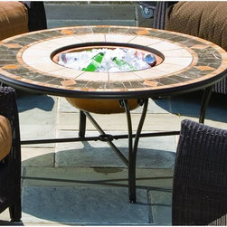 Alfresco Home - Compass Mosaic Fire Pit / Beverage Cooler Table - 21-1336 - Shop for Fire Pits and Fireplaces from Hayneedle.com! Beautiful and expertly crafted the Compass Mosaic Fire Pit / Beverage Cooler Table is the perfect table for entertaining. Expertly crafted from hand forged wrought iron the frame of this fire pit is dipped in a zinc-phosphate bath and E-coated to create a weather-resistant coating. It's finished with a powder coating to provide an extra layer of rust-resistant protection but also creates a stronger richer frame color that lasts for years. With each tile expertly laid by hand to create a unique mosaic table top this fire pit is a beautiful and well-crafted piece. Made from natural sources such as marble slate and travertine each tile varies slightly in color resulting in each fire pit being truly unique. The top is then grouted with industrial adhesives for durability so the natural beauty of this table is maintained. An iron fire bowl spark plate and wood grate are included so you can make warm fires to sit around in the evening while a beverage cooler bowl allows you to turn this fire pit into the perfect coffee table for entertaining during warm days. Or simply place the centerpiece on top and have a simple yet elegant coffee table at your disposal. Spend time playing outdoors with your kids while having plenty of cold drinks on hand or invite your friends over to warm themselves by the fire and enjoy the cool autumn air with this gorgeous fire pit and beverage cooler combination table. Whatever the occasion you now have the perfect place to celebrate right in your own backyard. Additional Features Doubles as a fire pit and beverage table Place cover on top to create a regular table Frame is weather and rust resistant Made with rust proof stainless steel hardware Iron has a thickness of 5mm to 6mm Mosaic tiles are hand-set Tiles come from natural sources Sources include marble slate and travertine Colors will vary slightly on each fire 