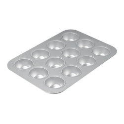 Chicago Metallic - Chicago Metallic Commercial II  12-Cup Muffin Pan - It's not magic: The secret of pro-quality baking is having pro-quality tools. This commercial-grade muffin pan is made the old-fashioned way from uncoated, heavy-weight aluminized steel, known for its superior heat conductivity and even baking. It's nontoxic, built to last and will give you perfectly browned muffins every time.