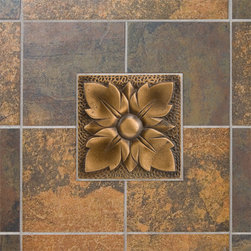 "4"" Solid Bronze Wall Tile with Wall Flower Design - Featuring a charming flower design, this intricate 4"" accent tile will add subtle detail and natural beauty to your kitchen or bath. This wall tile is made of solid bronze and is offered with an optional tile frame."