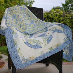 None - Francesca Quilted Throw - Add a lovely touch to any room with one of these double wedding ring quilted throws featuring vibrant yellow, blue, and green tones for a soft pop of color. When the weather gets cool, you can snuggle up under this cotton patchwork quilt to stay warm.