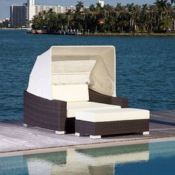 Resort Collection Outdoor Daybed - The Resort Collection outdoor daybed has a retractable canopy, deep seating cushion, wicker frame and ottoman.