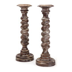 Pair of Twisted Candlesticks - These ethnical and traditional Pair of Twisted Candlesticks are made of wood. The curvy, rope shaped sticks look elegant and classy. These graceful candlesticks with hand rubbed finishing will accent the surroundings of your table.