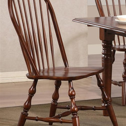 Sunset Trading - Eco-Friendly Windsor Chair - Traditional classic American beauty. Spindle back and chestnut seat. Perfectly carved and turned legs. Large backrest and seating area to provide ideal seating solution. Warranty: One year. Made from Malaysian oak. Chestnut finish. Made in Malaysia. No assembly required. 22 in. W x 20.5 in. D x 41 in. H (20 lbs.)This beautifully designed dining chair supplied by Sunset Trading will assure you many years of use and enjoyment. Complete your dining decor with the country charm of timeless casual dining chairs from the Sunset Trading Andrews Collection. Offering yet always dependably functional, your family and friends will enjoy the seating comfort of this inviting relaxed dining chairs for years to come. Pair with your choice of coordinating Sunset Trading Andrews Collection dining tables (not included) to bring a touch of country warmth with style to your home!