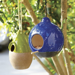 Birdhouse, Blue - Birdhouses are great for attracting nature to your backyard, and it's always fun watching squirrels try to infiltrate them! I just got the blue one as a gift and it looks gorgeous hanging on the maple tree in my backyard.